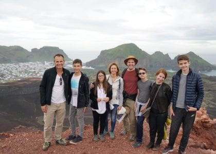 Happy visitors on top of Eldfell Vestmannaeyjar Westman Islands