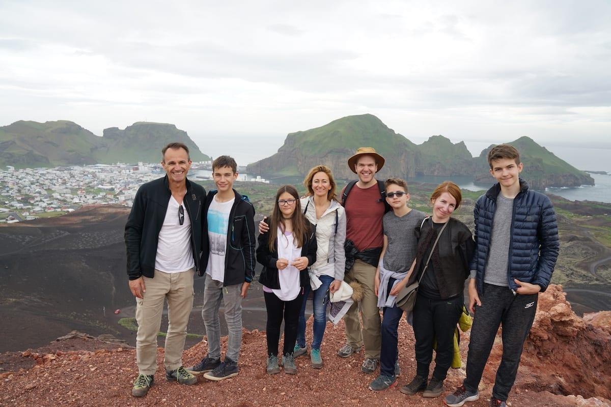 Happy visitors on top of Eldfell Vestmannaeyjar Westman Islands